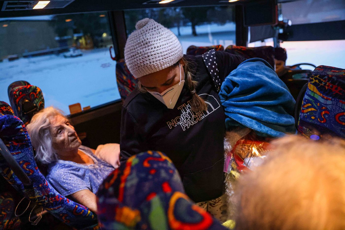 Marleny Almendarez, 38, makes her way into the bus that serves as a warming center at Pleasant Oaks Recreation Center for the second consecutive night on Wednesday, February 18, 2021 in Dallas.