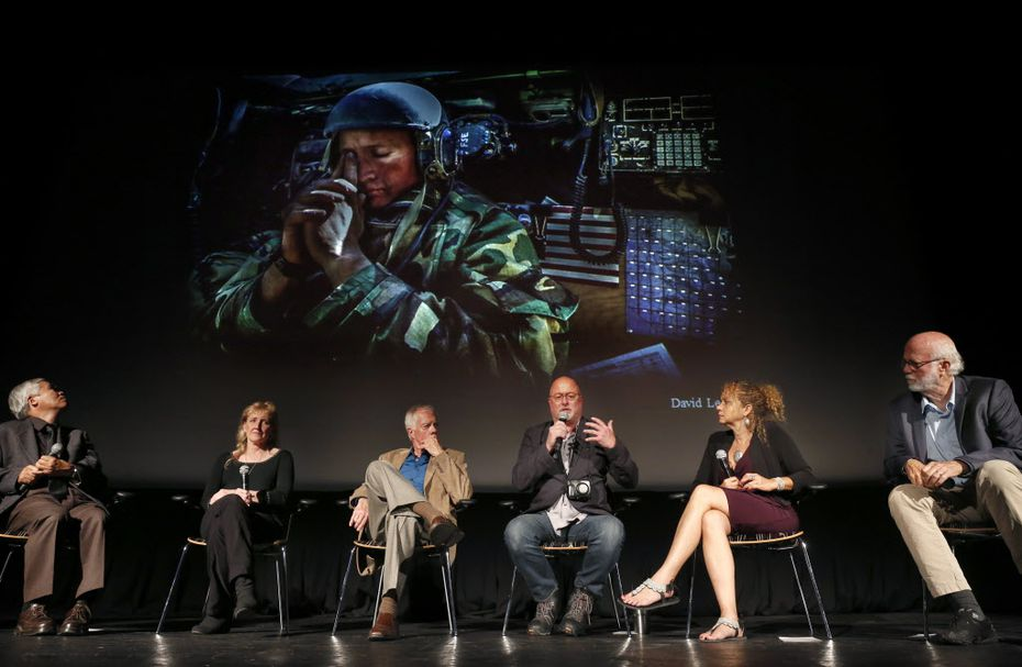 Former Dallas Morning News staff photographer and Pulitzer Prize winner David Leeson (center, right) discusses covering war during the Illusion & Disillusion: A Conversation with Pulitzer-Winning Photographers panel discussion at the Texas Theatre in Oak Cliff, Wednesday, September 21, 2016. The event featured five Pulitzer Prize-winning photographers including (from left) Nick Ut, Carol Guzy, Bob Jackson, Leeson, International Women's Media Foundation's inaugural Anja Niedringhaus Award winner Heidi Levine and David Hume Kennerly. The event, in conjunction with the 100th anniversary of the Pulitzer Prizes, also had Pulitzer Prize-winning readings and performances. The evening was presented by The Sixth Floor Museum and 29 Pieces.