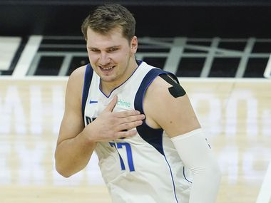 Dallas Mavericks guard Luka Doncic (77) celebrates after making a 3-pointer during the first quarter of an NBA playoff basketball game against the LA Clippers at the Staples Center on Wednesday, June 2, 2021, in Los Angeles.  (Smiley N. Pool/The Dallas Morning News)