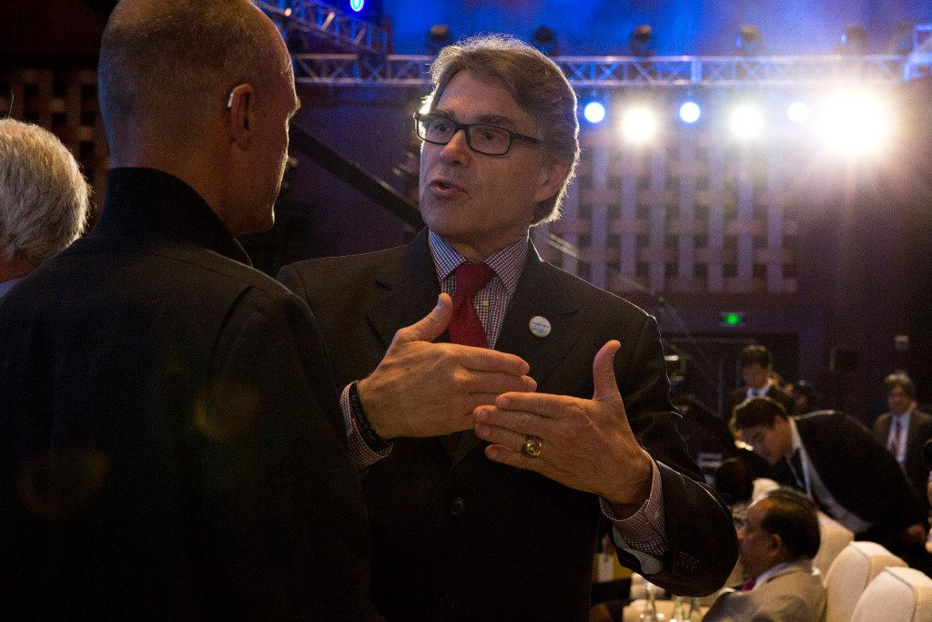 In this photo taken Wednesday, U.S. Energy Secretary Rick Perry attends the opening ceremony of an international clean energy conference held in Beijing, China. Energy ministers from around the world gathered in Beijing this week to report increased spending to help counter climate change. Yet one prominent voice, that of U.S. Energy Secretary Rick Perry, delivered a starkly countervailing message as the Trump administration seeks to roll back spending on clean energy and promote fossil fuels.