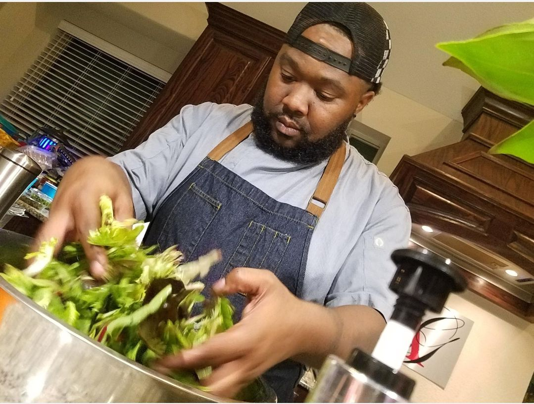 Cal Abbott prepares a salad for his Dallas catering company, Destination Catering and Events. Abbott's apartment complex took him to court over what he describes as a wrongful eviction.