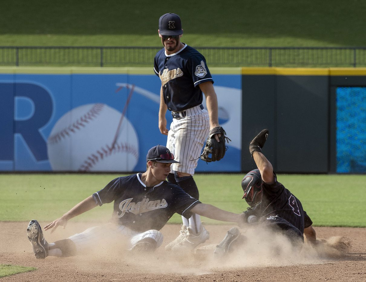 Rockwall-Heath Jett Williams, (4), is tagged out at second base by Keller Todd Baffa, (2), as Aidan Connors, (4), looks on during the seventh inning of the 2021 UIL 6A state baseball final held, Saturday, June 12, 2021, in Round Rock, Texas.  Rockwall-Heath defeated Keller 4-3.   (Rodolfo Gonzalez/Special Contributor)