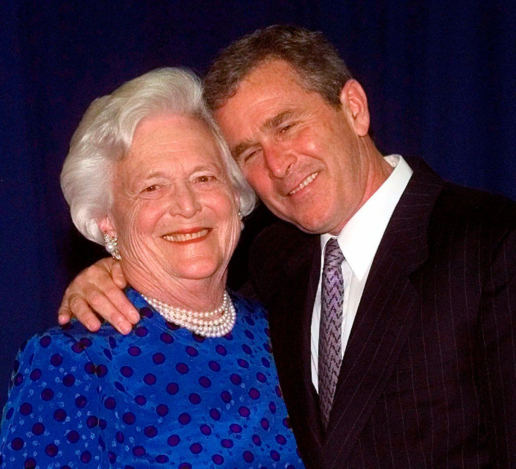 In this June 10, 1999,  photo, then-Texas Gov. George W. Bush, right, gives his mother, Barbara Bush, a hug after taking a family photo in Houston. A family spokesman said Tuesday, April 17, 2018, that former first lady Barbara Bush has died at the age of 92.