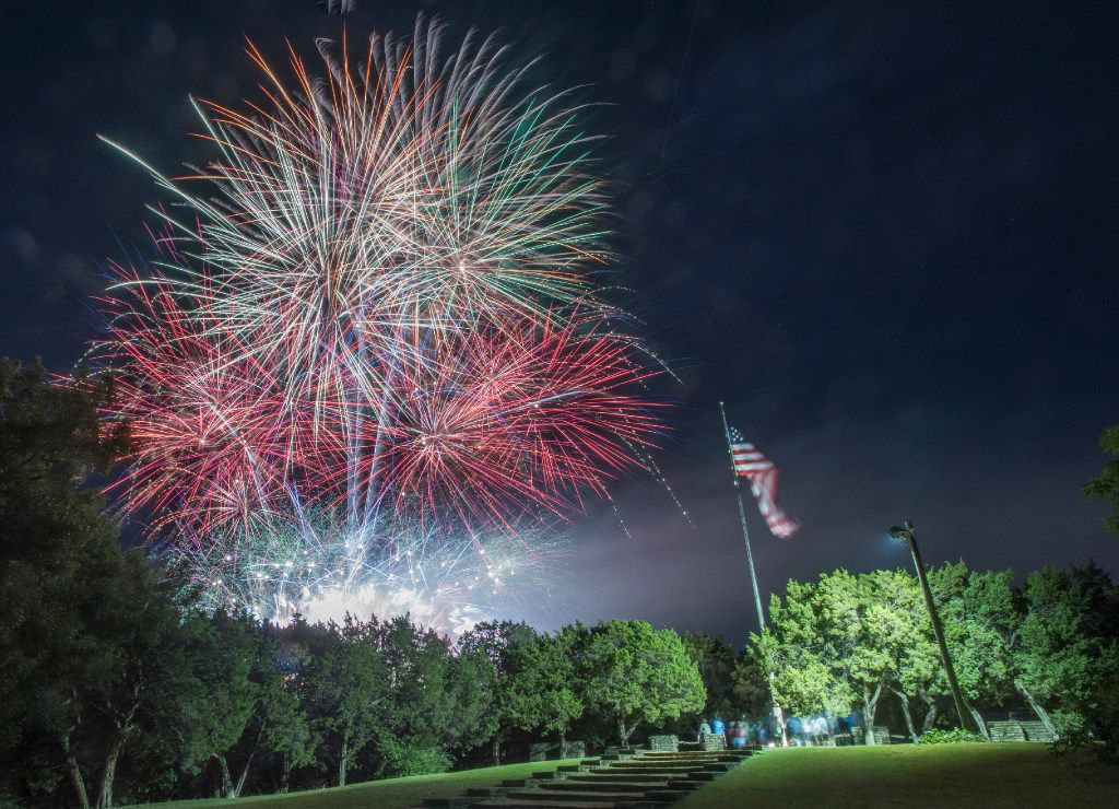 Fireworks explode over Flag Pole Hill after the Dallas Symphony Orchestra's Memorial Day concert in 2017.