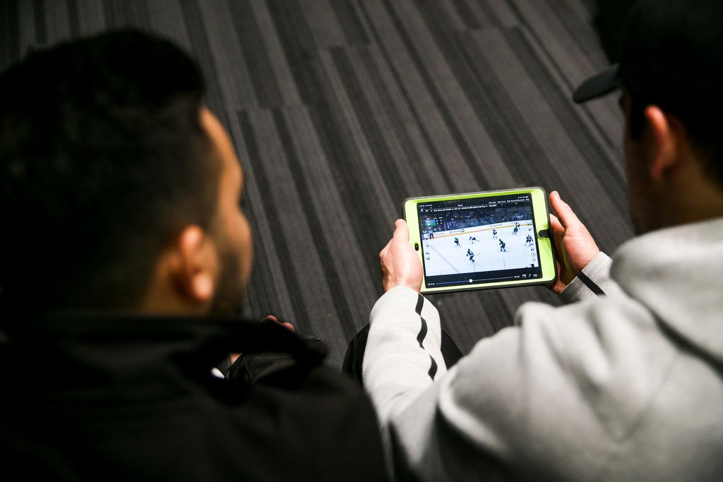 Dallas Stars defender Taylor Fedun goes over film with The Dallas Morning News writer Matt DeFranks following practice at Comerica Center in Frisco, Texas on Friday, Feb. 22, 2019. (Shaban Athuman/The Dallas Morning News)