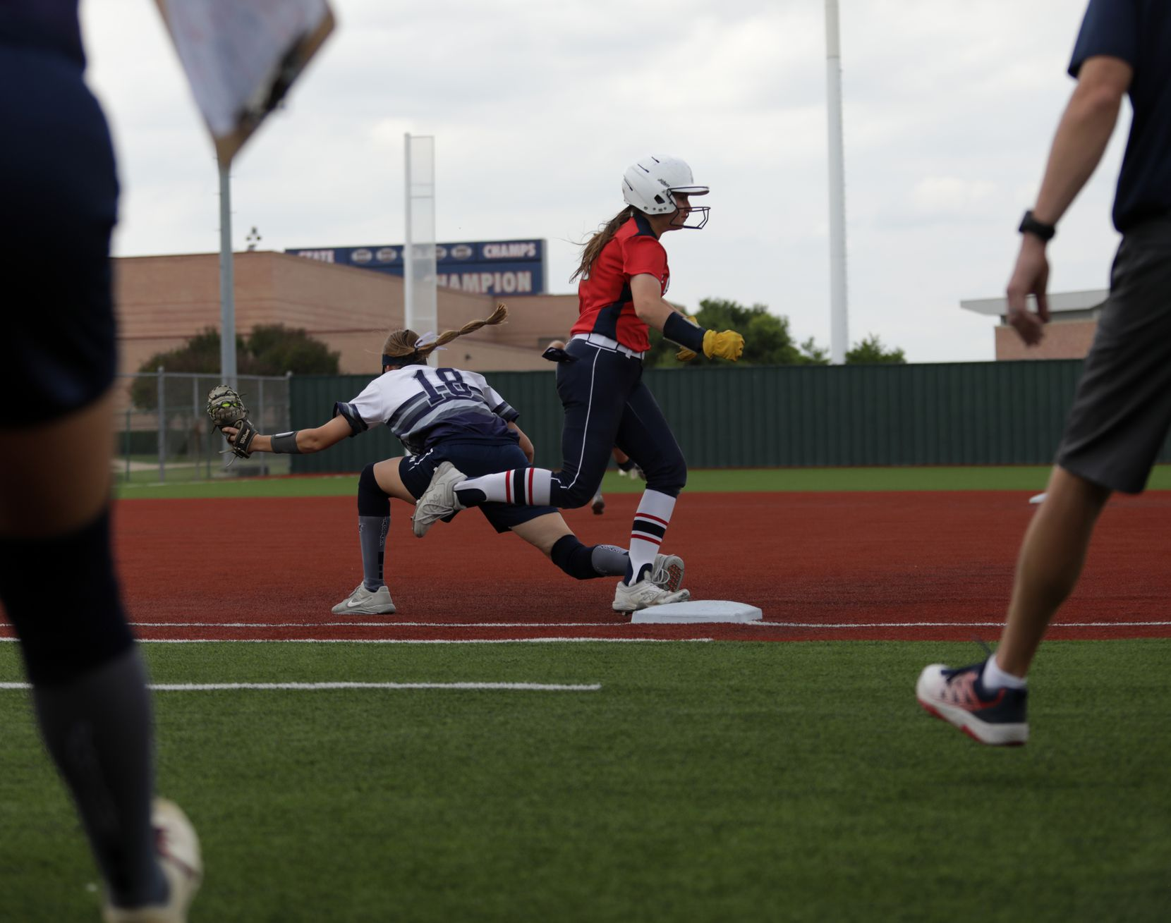 Flower Mound High School player #18, Jordyn Holland, takes out Allen High School player #10, Alexis Telford, during a softball playoff game at Allen High School in Allen, TX, on May 15, 2021. (Jason Janik/Special Contributor)