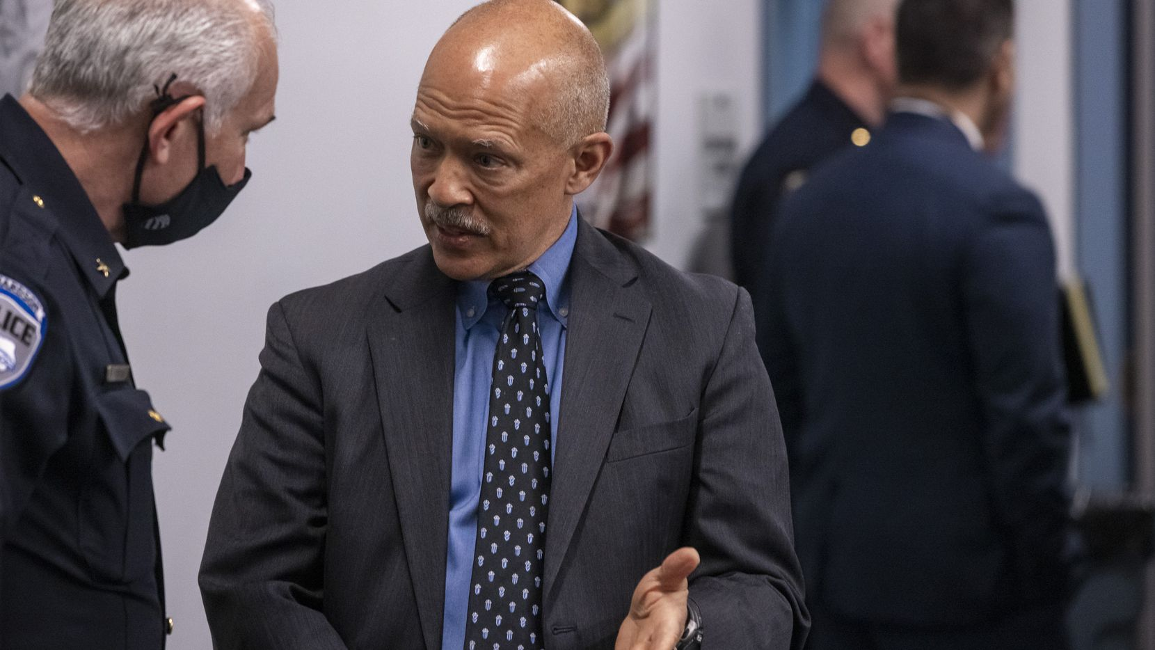 Dallas District Attorney John Creuzot, right, chats with recently promoted Richardson Police Chief Gary Tittle during an open house held for media at the new downtown location of the North Texas Regional Computer Forensics Laboratory (NTRCFL) in Dallas on May 11, 2021. The Dallas FBI and regional law enforcement work to solve computer crimes from this location, which has new features, such as an expanded training room. The NTRCFL is one of 17 laboratories in the country, serving as a full-service digital forensics laboratory and training center devoted entirely to the examination of digital evidence.