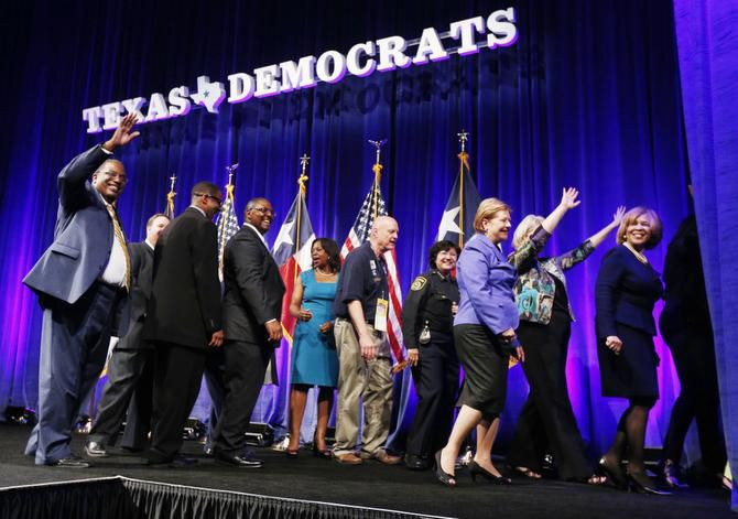 Democratic officials from Dallas, including state Sen. Royce West (left), filled the stage at a Texas Democrats State Convention at the Kay Bailey Hutchison Convention Center.