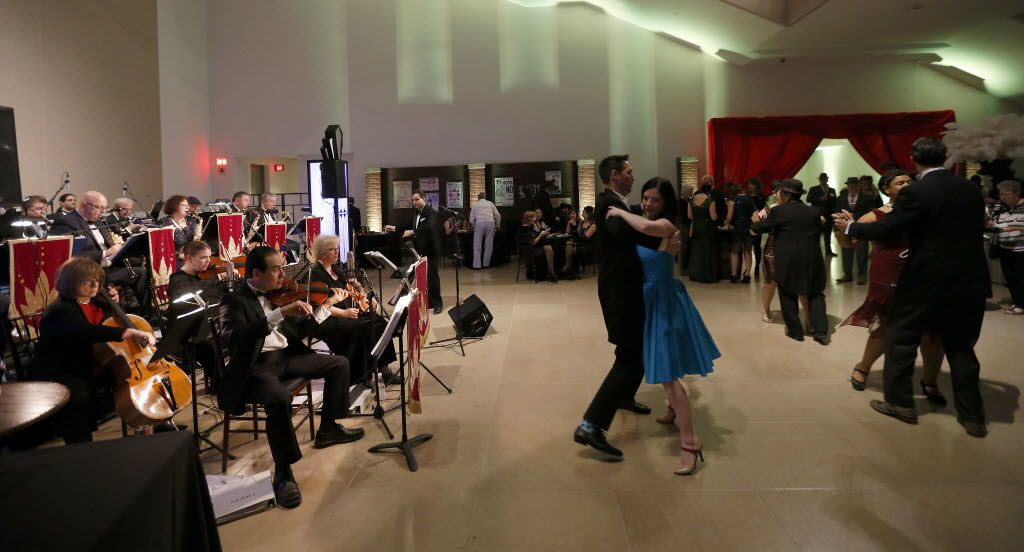 Guests dance on the floor during the DMA Speakeasy event in celebration of Shaken Stirred Styled: The Art of the Cocktail at Dallas Museum of Art in Dallas, Saturday, Feb. 4, 2017.