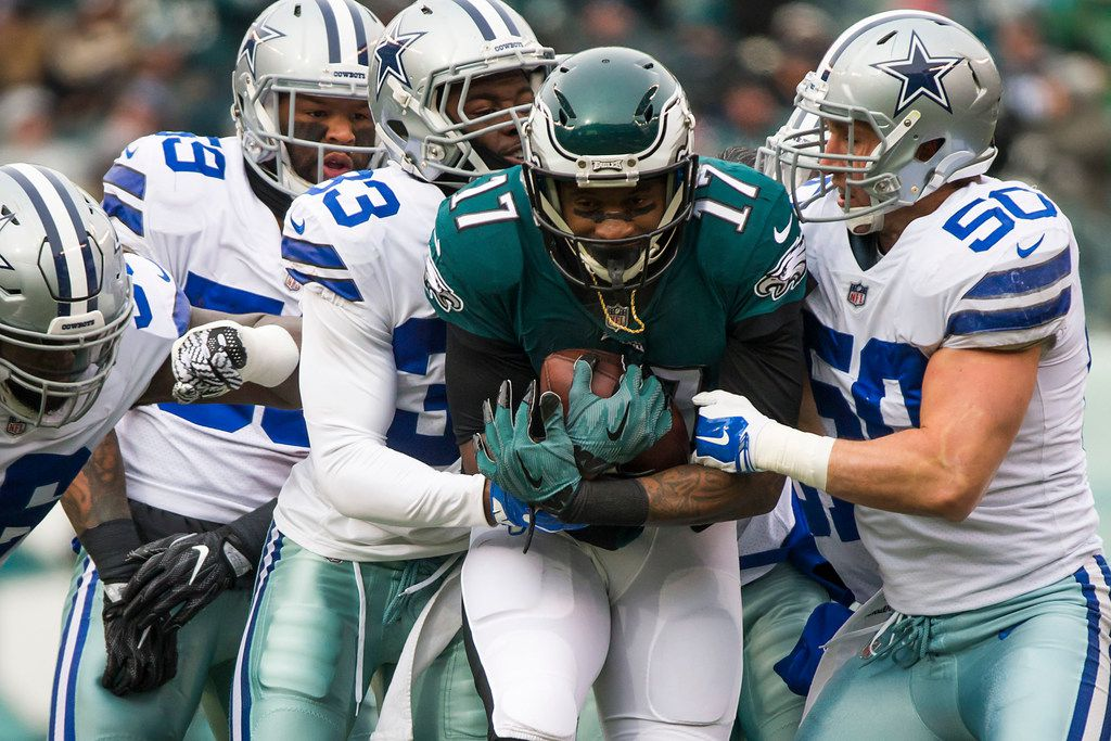 Philadelphia Eagles wide receiver Alshon Jeffery (17) is wrapped up by Dallas Cowboys cornerback Chidobe Awuzie (33) and middle linebacker Sean Lee (50) during the first half an NFL football game on Sunday, Dec. 31, 2017, in Philadelphia. (Smiley N. Pool/The Dallas Morning News)