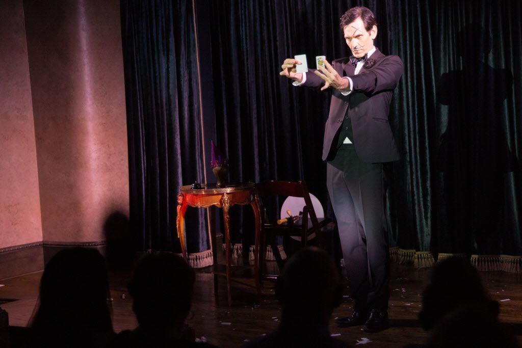 Magician Zabrecky performs on stage at the Peacock Theater.