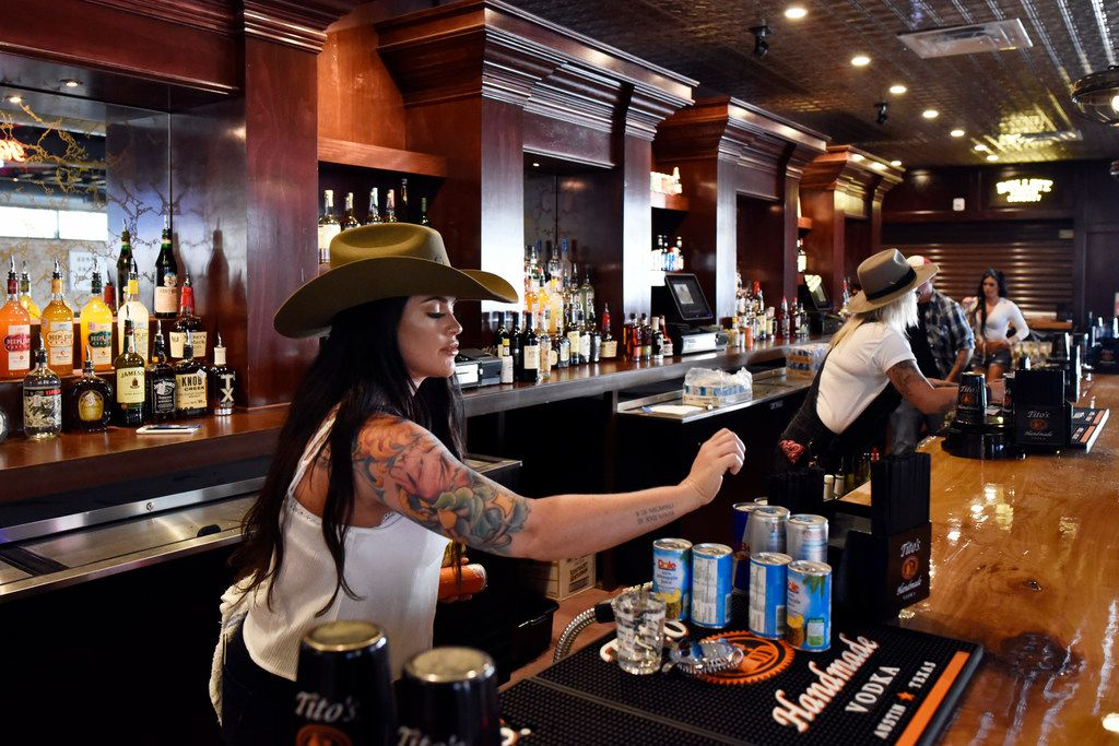 Bartender Carly Campbell tends to the bar before the opening of Mama Tried, the new restaurant and honky tonk bar in Deep Ellum, Wednesday, July 18, 2018 in Dallas. Ben Torres/Special Contributor