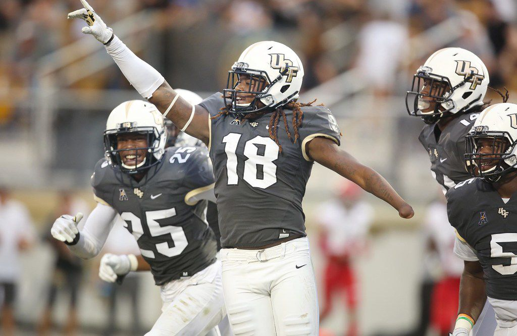 UCF linebacker Shaquem Griffin (18) celebrates after returning a fumble 20 yards for a touchdown in the second quarter against Austin Peay at Spectrum Stadium in Orlando, Fla., on Saturday, Oct. 28, 2017. UCF won, 73-33. (Stephen M. Dowell/Orlando Sentinel/TNS)