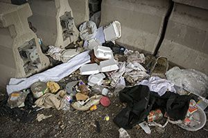 Trash left behind in a homeless encampment off Coombs Street Wednesday, May 11, 2016 in Dallas. (G.J. McCarthy/The Dallas Morning News)