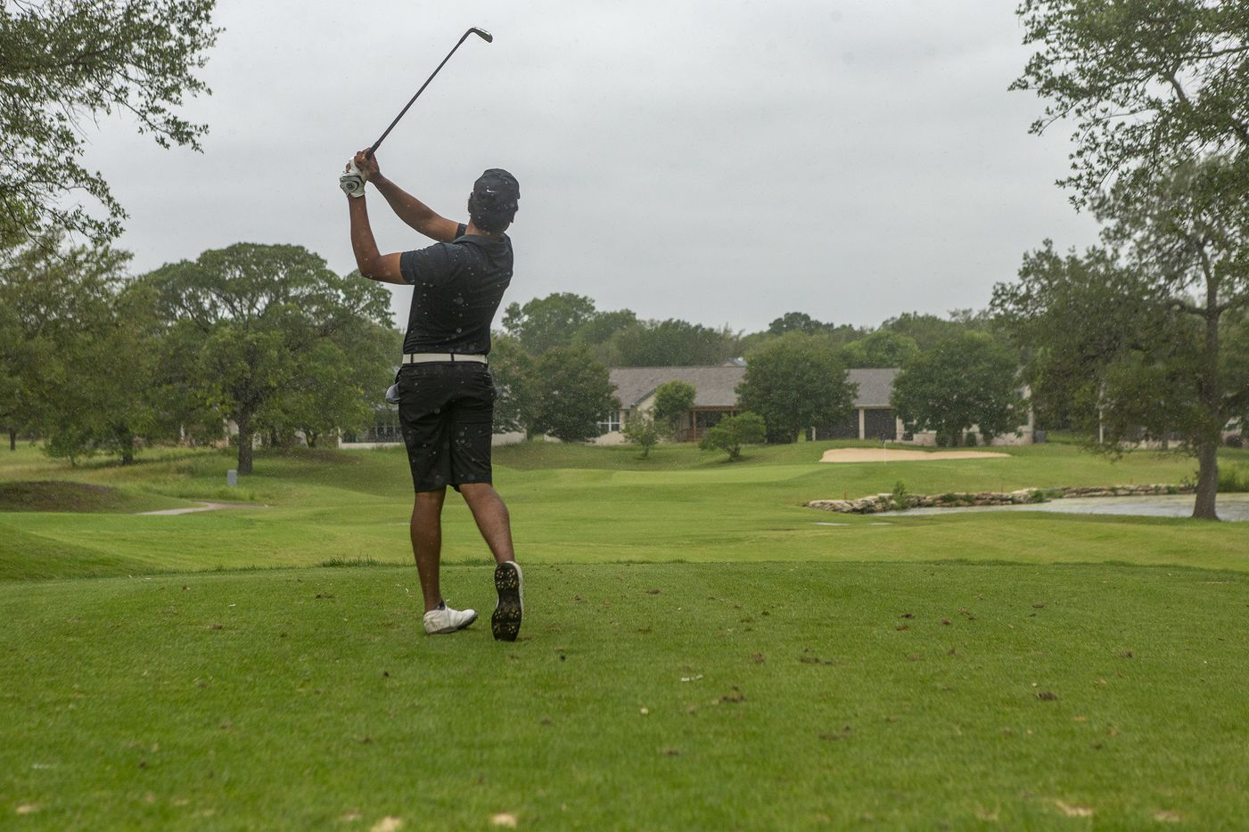 Plano WestÕs Rohan Aerrabolu hits from the 4th tee box in the rain during the final round of the UIL Class 6A boys golf tournament in Georgetown, Tuesday, May 18, 2021. (Stephen Spillman/Special Contributor)