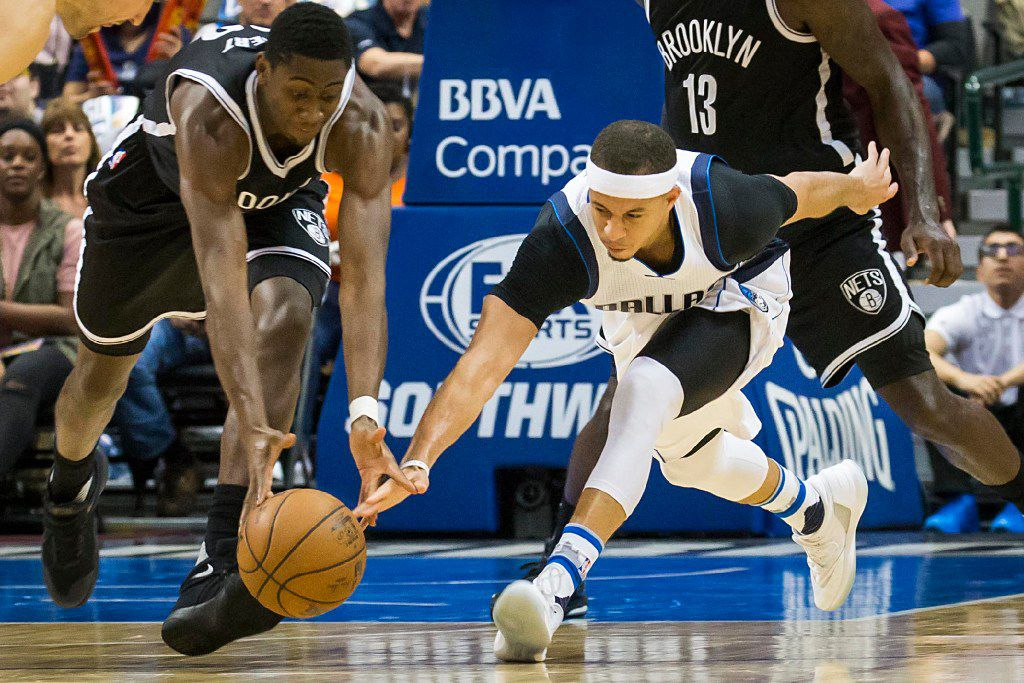 Dallas Mavericks guard Seth Curry (30) fights for a loose ball against Brooklyn Nets guard Caris LeVert (22) during the first half of an NBA basketball game at American Airlines Center on Friday, March 10, 2017, in Dallas. (Smiley N. Pool/The Dallas Morning News)