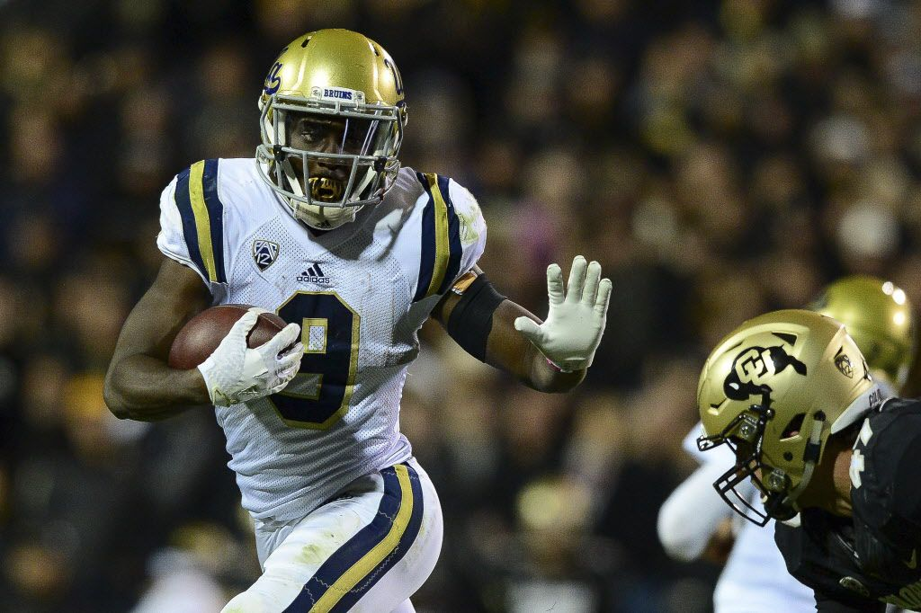 BOULDER, CO - NOVEMBER 3:  Running back Soso Jamabo #9 of the UCLA Bruins rushes against the Colorado Buffaloes at Folsom Field on November 3, 2016 in Boulder, Colorado.  (Photo by Dustin Bradford/Getty Images) ORG XMIT: 678602373