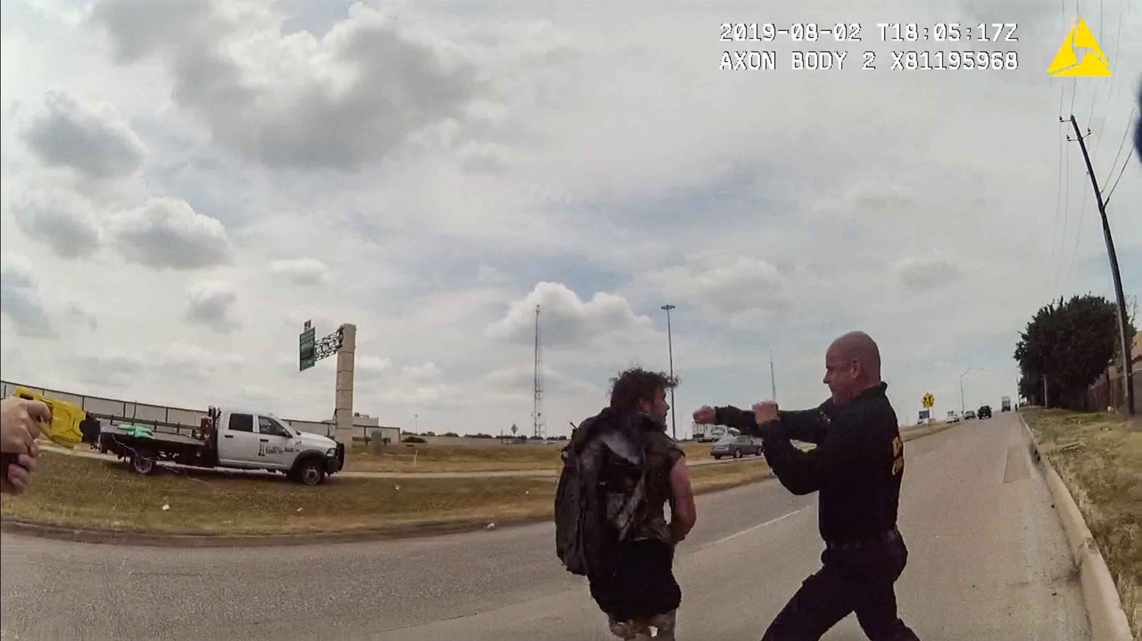 A frame from a police body cam shows Dallas firefighter Brad Cox during an altercation with Kyle Robert Vess on Aug. 2, 2019.