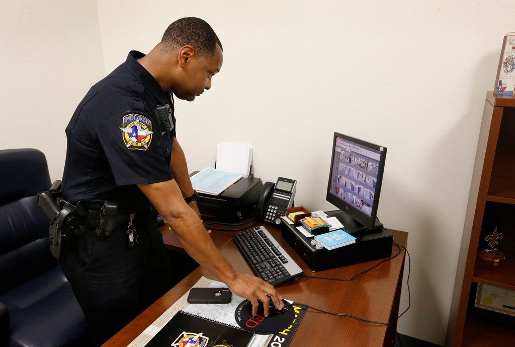 McKinney police officer Bryant Bailey demonstrates the security system at McKinney North High School in McKinney on March 5.