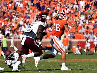 Clemson quarterback Trevor Lawrence (16) passes while pressured by Texas A&M's Bobby Brown during the first half of an NCAA college football game Saturday, Sept. 7, 2019, in Clemson, S.C.