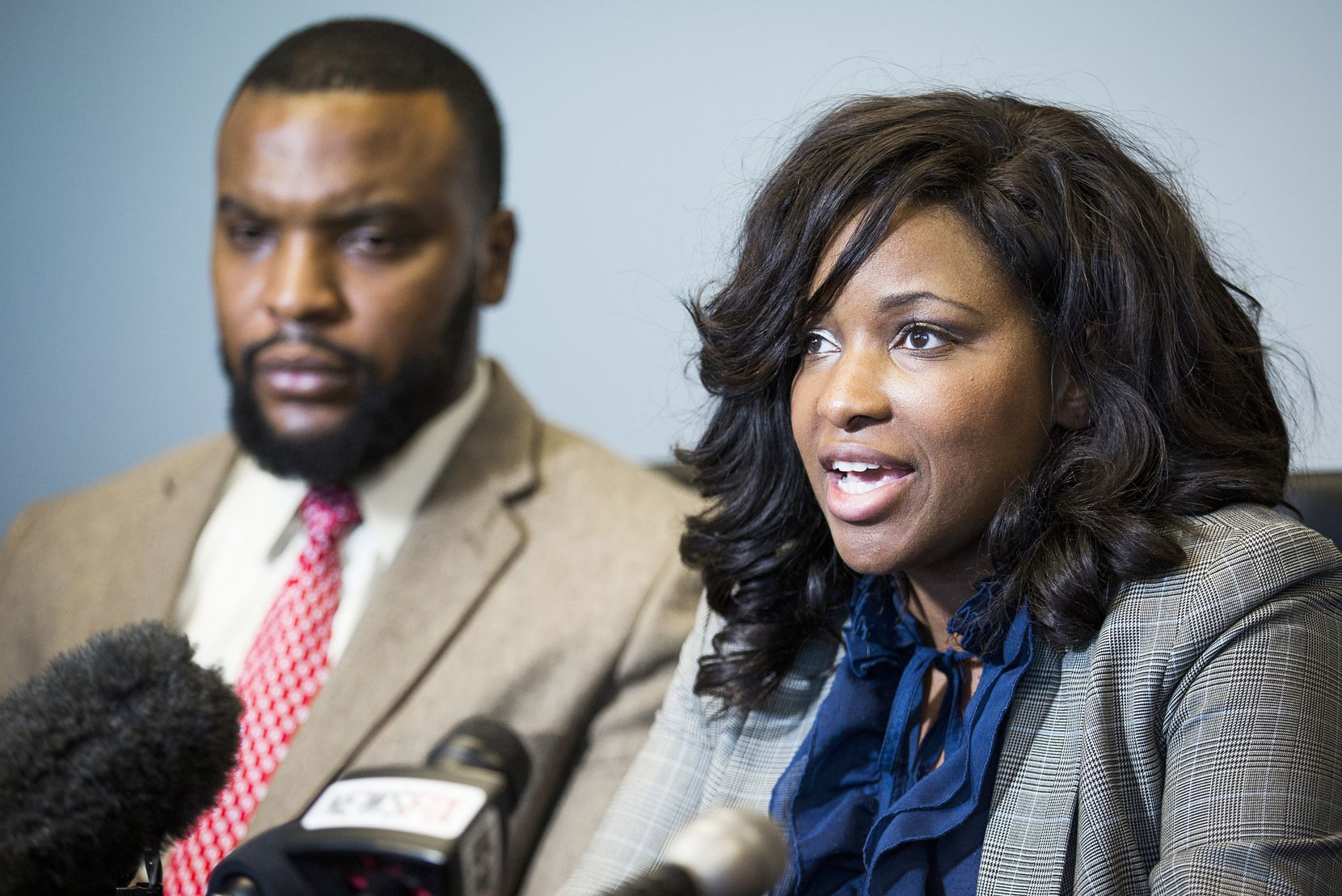 Attorneys Jasmine Crockett (front) and Lee Merritt, who represent Jacqueline Craig, hold a press conference at their offices on Thursday, Jan. 26, 2017, in Dallas.