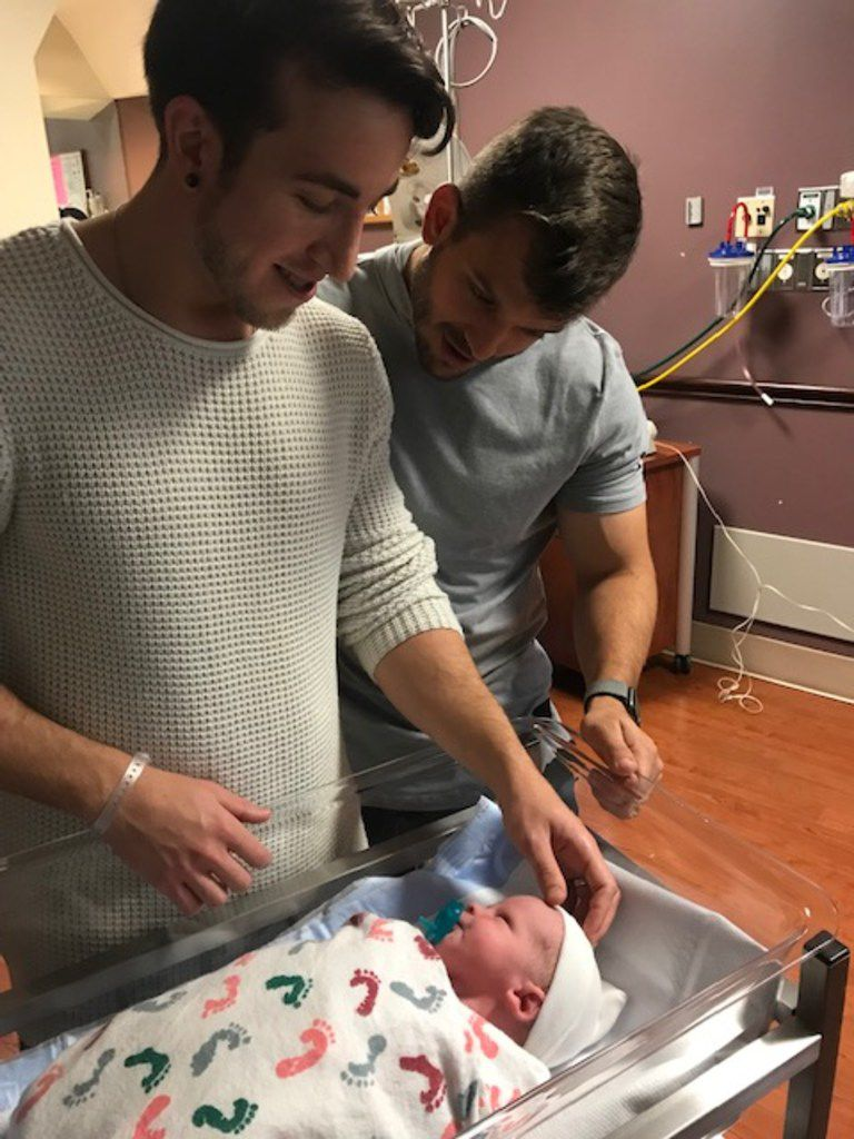 Dallas residents Alex Reyher (left) and Ryan Layman (right) welcome their newborn, Rory. The couple chose surrogacy in their family planning and ended up influencing a change in how Layman's employer, PwC, provides benefits like surrogacy reimbursement.