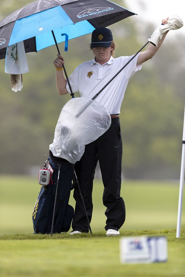 Highland ParkÕs Thompson Huthnance prepares to play in the rain on the 10th tee box during round 1 of the UIL Class 5A boys golf tournament in Georgetown, Monday, May 17, 2021. (Stephen Spillman/Special Contributor)