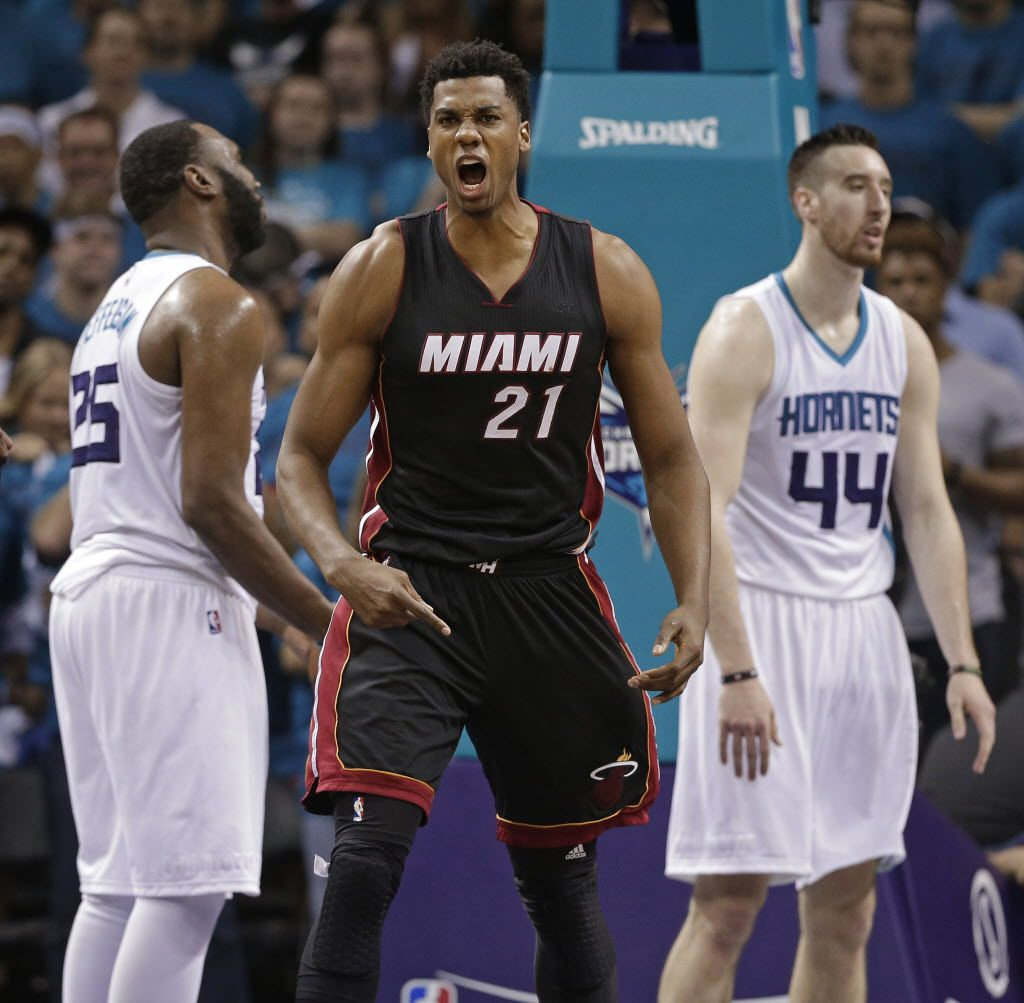 FILE - In this Friday, April 29, 2016, file photo, Miami Heat's Hassan Whiteside (21) reacts to making a basket and being fouled by Charlotte Hornets' Frank Kaminsky (44) during the second half in Game 6 of an NBA basketball playoffs first-round series in Charlotte, N.C. Whiteside will be one of the most coveted targets when free agency begins FrIday, July 1, and there's no guarantee that the center whose career was resuscitated by the Miami Heat will be back with them next season. (AP Photo/Chuck Burton, File)
