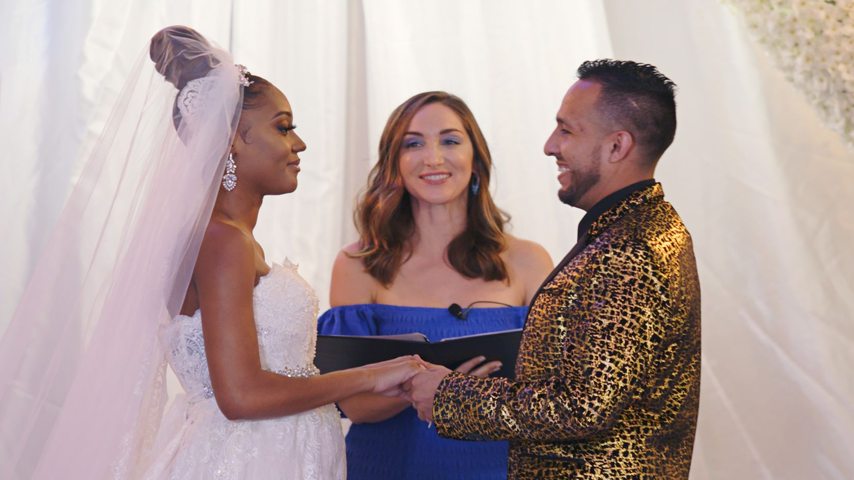 """""""The Wedding Coach"""" host Jamie Lee (center) offered some support to Savannah and Cesar, who wanted a bilingual wedding ceremony."""