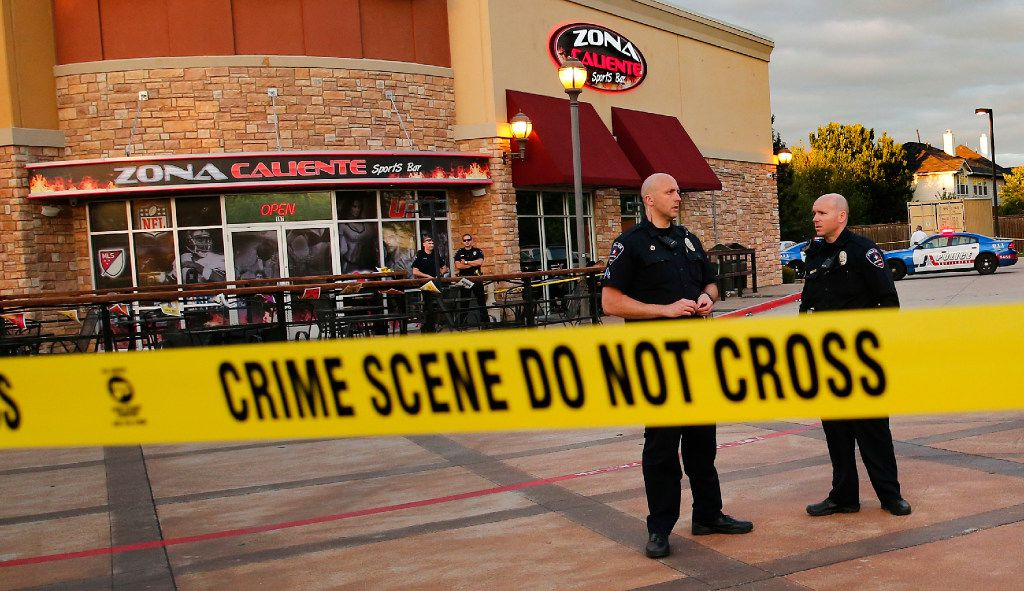 Arlington police investigate a shooting in which two people were found dead at the Zona Caliente Sports Bar and Grill on South Cooper Street in Arlington.