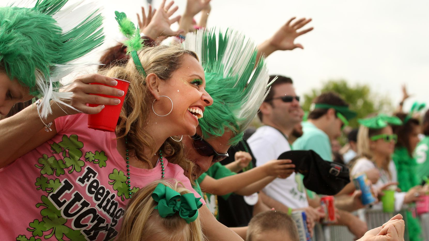 Kolleen Kiburz of Dallas tries to catch beads during St. Patrick's Day Parade on Greenville Avenue.