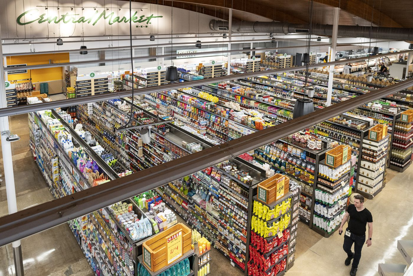 A general overall view from the second level  balcony of the rebuilt Central Market. Upstairs has a community room. There's also a balcony with tables and seating downstairs in the coffee shop. The store has prepared foods, baked good and a sandwich station.