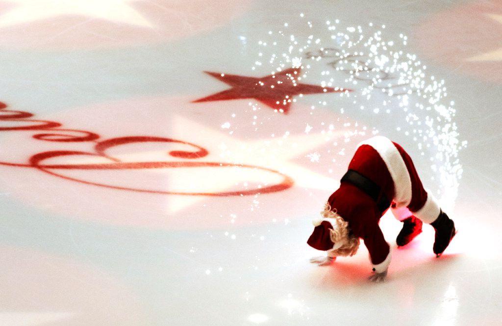 Santa Claus performs during the Macy's Grand Tree Lighting Celebration at Galleria Dallas on Black Friday, November 25, 2016 in Dallas, Texas. (David Woo/The Dallas Morning News)