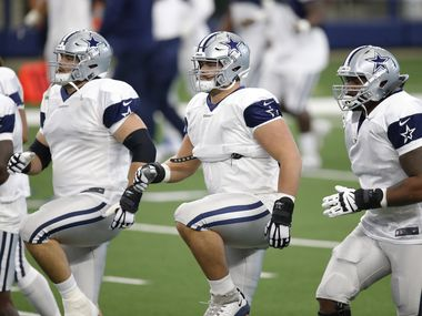 Dallas Cowboys guard Zack Martin (70), Dallas Cowboys guard Connor Williams (52) and Dallas Cowboys offensive tackle Tyron Smith (77) stretch for practice on Cowboys Night during training camp at AT&T Stadium in Arlington, Texas on Sunday, August 30, 2020.