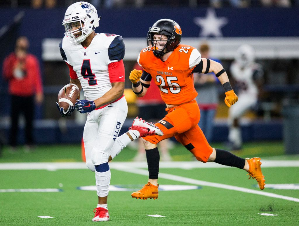 Allen wide receiver Darrion Sherfield (4) runs to the end zone for a touchdown ahead of Rockwall defensive back Corey Kelly (25) during the first quarter  of a Class 6A Division I area-round high school football playoff game between Allen and Rockwall on Friday, November 22, 2019 at AT&T Stadium in Arlington. (Ashley Landis/The Dallas Morning News)