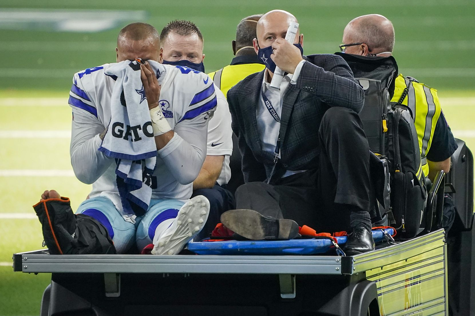Dallas Cowboys quarterback Dak Prescott leaves the field on a cart after being injured on a tackle by New York Giants cornerback Logan Ryan during the third quarter of an NFL football game at AT&T Stadium on Sunday, Oct. 11, 2020, in Arlington.
