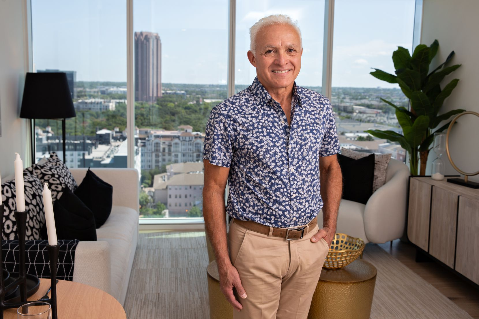Al Coker, CEO of Al Coker & Associates, stands in one of the studio condos offered at One Uptown on McKinney Avenue in Uptown Dallas.