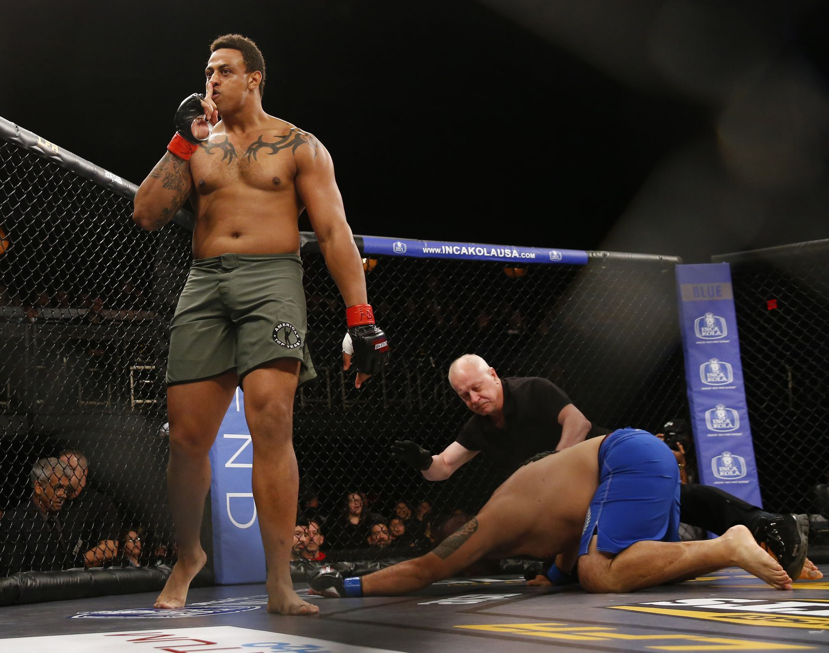 Former Cowboy Greg Hardy celebrates knocking Ryan Chester out in the first 14 seconds during an amateur heavyweight fight at The Bomb Factory in Dallas on Feb. 16, 2018.  (Nathan Hunsinger/The Dallas Morning News)