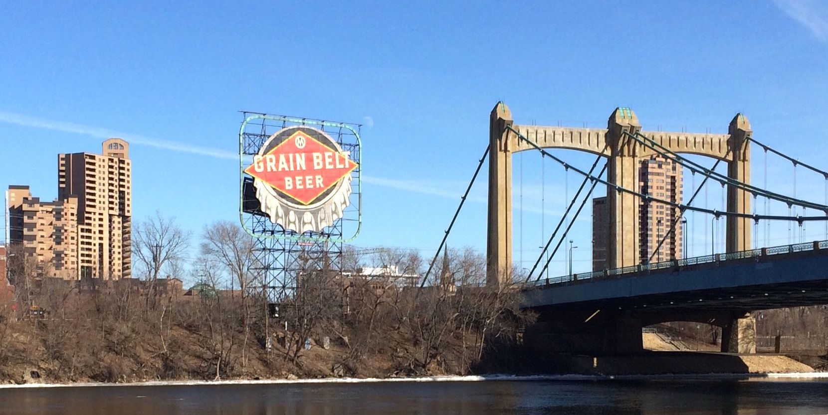 This billboard on Minneapolis' Third Avenue Bridge recalls when Grain Belt beer was brewed in the city. It's now produced by August Schell in New Ulm, Minn.