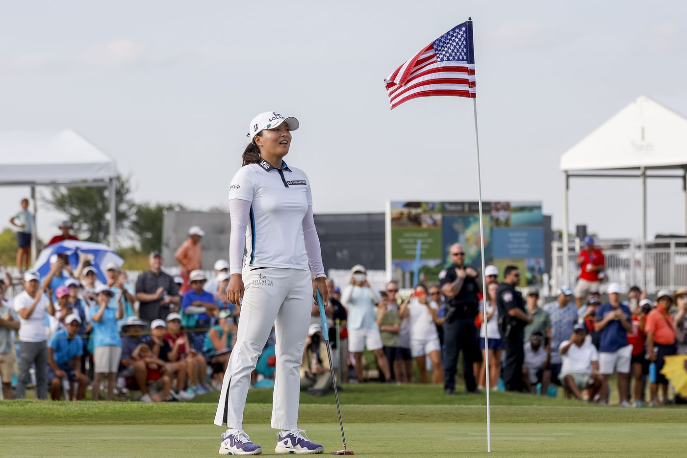 Professional golfer Jin Young Ko reacts after making the winning putt on the No. 18 green during the final round of the LPGA VOA Classic on Sunday, July 4, 2021, in The Colony, Texas. Ko won the tournament at 16 under par.  (Elias Valverde II/The Dallas Morning News)
