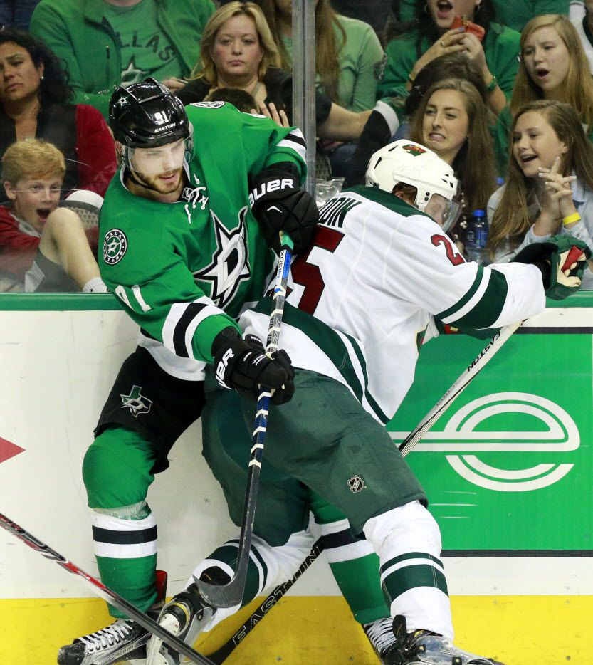 Dallas Stars center Tyler Seguin (91) got tangled up with Minnesota Wild defenseman Jonas Brodin in Game 2 of the Western Conference quarterfinals at American Airlines Center. The April 16 game was the last in which Seguin appeared.