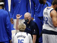 Dallas Mavericks head coach Rick Carlisle talks with his players during a timeout during the first quarter of a preseason game with the Minnesota Timberwolves at the American Airlines Center in Dallas, Thursday, December 17, 2020. (Tom Fox/The Dallas Morning News)