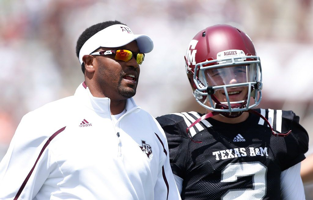 Head coach Kevin Sumlin of the Texas A&M Aggies chats with his quarterback Johnny Manziel before the Maroon & White spring football game at Kyle Field on April 13, 2013 in College Station, Texas.