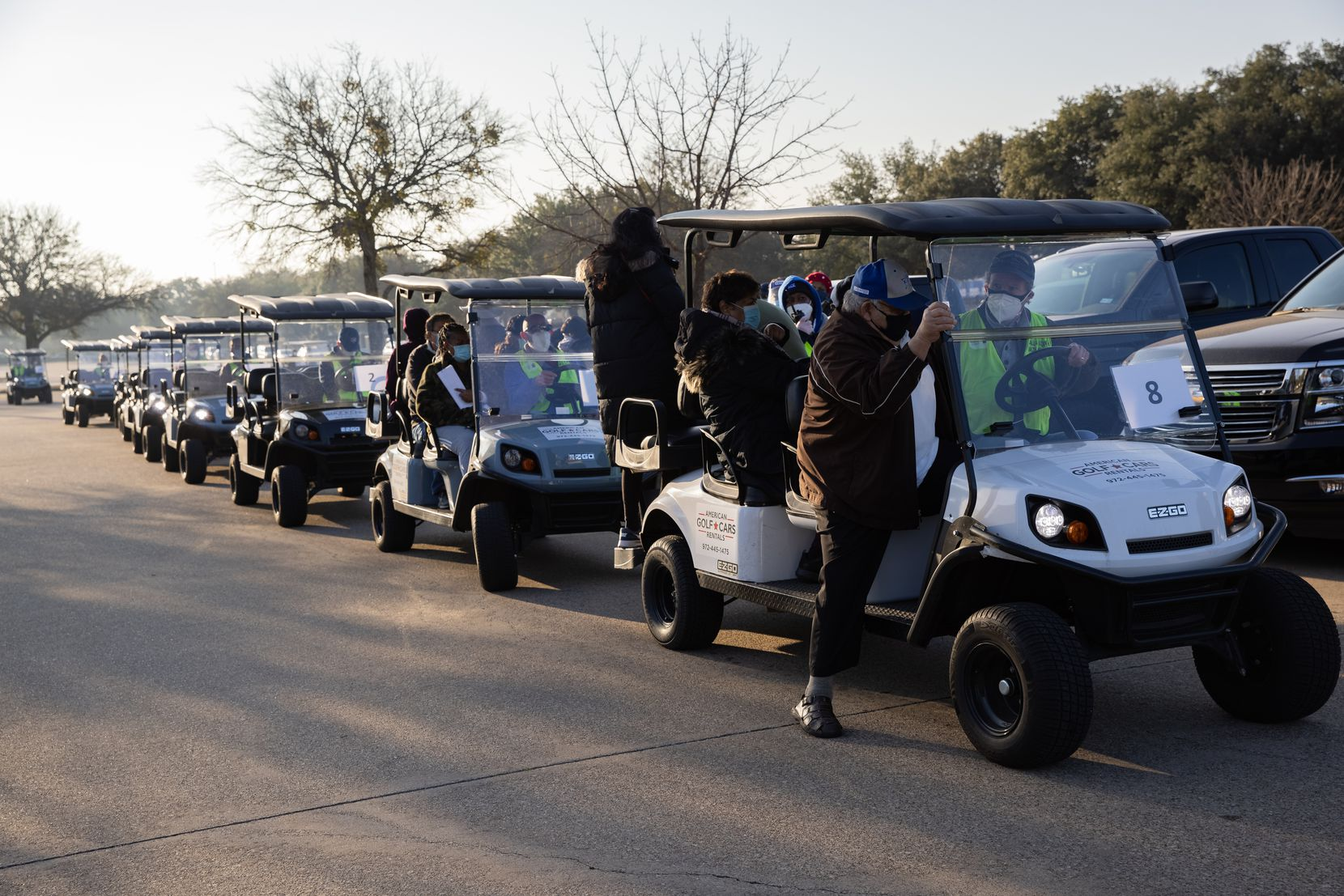 Golf carts were used in Fair Park to transport people receiving the COID-19 vaccine in late January 2021 in Dallas.