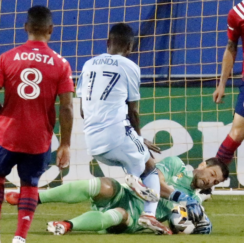 Sporting Kansas City midfielder Gadi Kinda (17) has his scoring attempt foiled by FC Dallas goalkeeper Jimmy Maurer during the first half as FC Dallas hosted Sporting Kansas City at Toyota Stadium in Frisco on Wednesday, September 29, 2021. (Stewart F. House/Special Contributor)