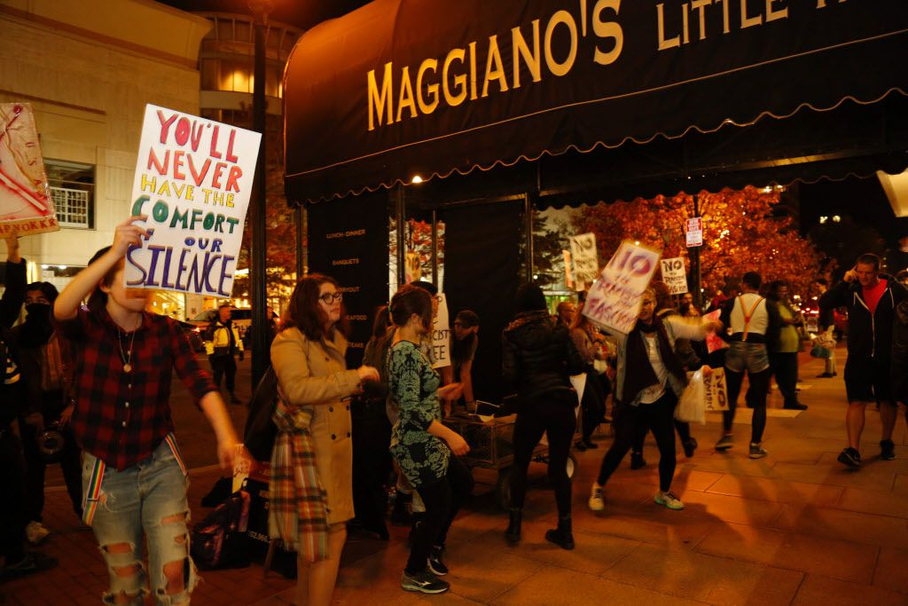 Members of DC Antifascist Coalition protest in opposition to a conference by the National Policy Institute in front of the Maggiano's restaurant in Washington, DC on November 18, 2016.