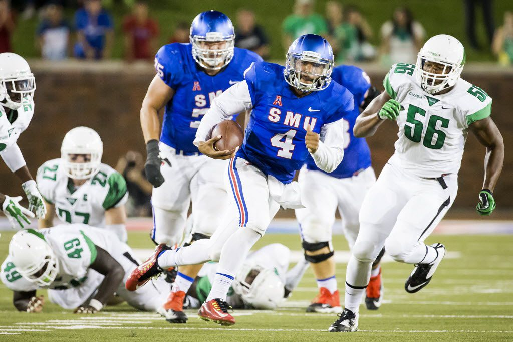 SMU quarterback Matt Davis (4) breaks through the North Texas defense on a 50-yard touchdown run during the fourth quarter of an NCAA football game at Ford Stadium on Saturday, Sept. 12, 2015, in Dallas. (Smiley N. Pool/The Dallas Morning News)