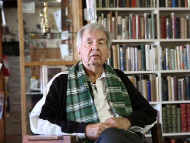 In this April 30, 2014, file photo, Pulitzer Prize-winning author Larry McMurtry poses at his book store in Archer City, Texas. Writers and students gathered in Archer City on Oct. 9 to honor him after his death.