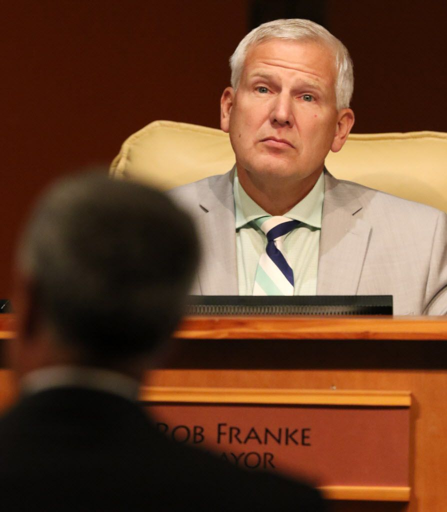 Cedar Hill Mayor Bob Franke listens during a City Council meeting in the town's government center.