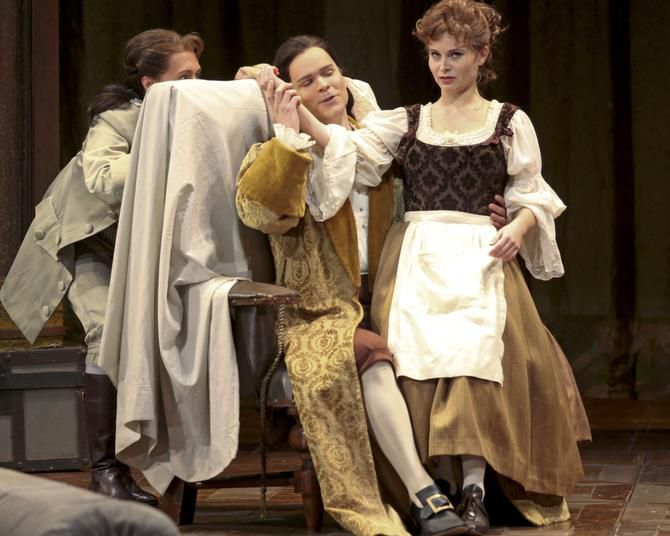In a scene from Dallas Opera's Marriage of Figaro, Cherubino (Emily Fons, left) spies on Count Almaviva (Joshua Hopkins) and Susanna (Beate Ritter).